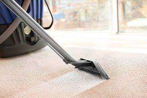 Using carpet extractor machine