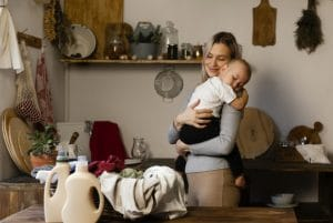 mother holding baby after safe eco cleaning