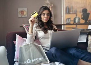 Woman shopping online from home